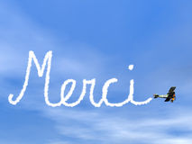 Merci, francês agradece-lhe mensagem, do fumo biplan Imagem de Stock