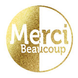 Merci in golden. Merci Beaocoup in bright gold Stock Photography