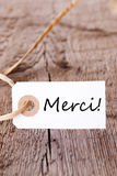 Merci Label on Wood Stock Image