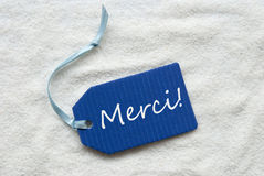 Merci Mean Thank You On Blue Label Sand Background Royalty Free Stock Photos
