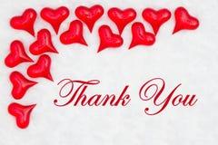 Merci message avec les coeurs rouges photos stock