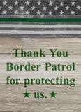 Merci message sur un drapeau mince am?ricain de Ligne Verte des agents de patrouille de fronti?re image libre de droits