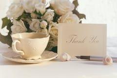 Merci noter avec la tasse de thé Images libres de droits