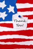 Merci noter sur le drapeau de papier américain photo libre de droits