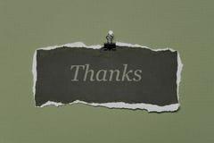 Merci noter sur une partie de papier de déchirure Photographie stock libre de droits