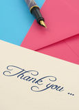 Merci pour noter et les enveloppes Photo stock