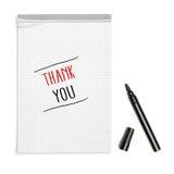 Merci sur le carnet avec le stylo noir images stock