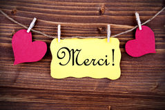 Merci on a Tag Framed By Hearts Royalty Free Stock Images