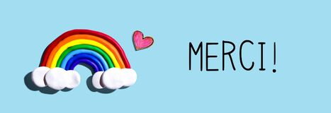 Merci - Thank you in french language with rainbow and heart