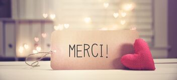 Merci - Thank you in French language with a red heart