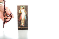Merciful Jesus with blank ribbon and Rosary beads Stock Image