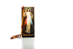 Merciful Jesus with blank ribbon and Rosary beads Stock Photos