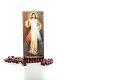 Merciful Jesus image and Rosary beads Stock Image