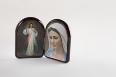 Merciful Jesus and Our Lady of Medjugorje icons. Merciful Jesus and Our Lady of Medjugorje, the Blessed Virgin mary, icons in a wooden rounded case isolated on Royalty Free Stock Photography