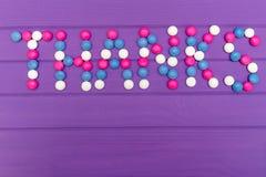 Mercis de Word garnis de la sucrerie colorée Photo stock