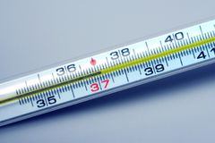 Mercurial thermometer.37 degrees Stock Photos