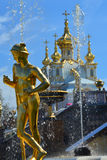 Mercury Capitoline and Church building in Peterhof, St. Petersburg, Russia. Mercury Capitoline of Big Fontain cascade in Lower garden of Peterhof, St. Petersburg Royalty Free Stock Photography