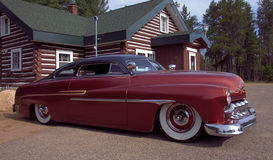 The Mercury. I found this beautiful classic Mercury parked outside its owner`s bar north of Tomahawk.  The dark copper colored paint job blends wonderfully with Stock Images
