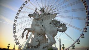 Mercury riding Pegasus statue and giant Ferris wheel in Tuileries Garden, Paris