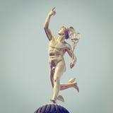 Mercury Statue. Roman God Mercury with retro style effect stock photography