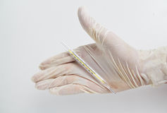 Mercury temperature with rubber gloves. Stock Photography