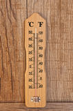 Mercury thermometer. Detail of mercury thermometer on wooden texture background Royalty Free Stock Photography