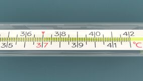 Mercury thermometer isolated and from different angles, temperature checking