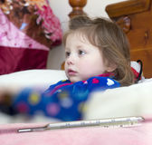 Mercury thermometer and a little sick girl Stock Photography