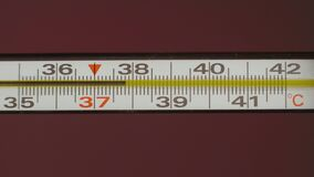 Mercury thermometer on RGB background. Temperature rises to 40 degrees Celsius