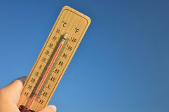 Mercury wooden thermometer Stock Photo
