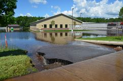 Mercy Wellness Center in Flood. Moose Lake, MN - June 23, 2012 - Flood waters surrounding Mercy Wellness Center in downtown Moose Lake, MN Stock Photos