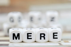 Mere, dice letters. Mere writte with dice letters Royalty Free Stock Photo