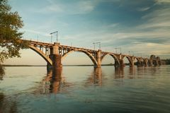 `Merefa-Kherson` railway bridge. Across the Dnieper River in Dnepropetrovsk Ukraine, urban landscape stock photos