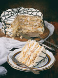 Merengue cake with cream and peanuts Stock Photography