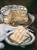 Merengue cake with cream and peanuts Royalty Free Stock Images