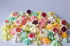 Merengue colorida merengues coloridas muitas doce diferente Foto de Stock