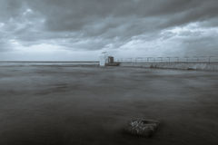 Merewether - Ocean Baths Pumphouse. Merewether Ocean Baths Pump House - Black and White on a cloudy morning sunrise. This ocean bath and pumphouse are a famous Royalty Free Stock Photos