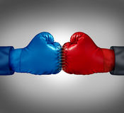 Merge Powers. Business concept as two boxing gloves sewed and stitched together with thread as a metaphor for competitors joining forces for a united fight to Royalty Free Stock Photography