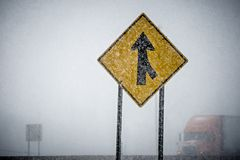Merge sign barely seen through winter storm Stock Images