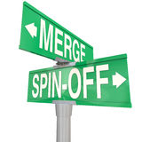 Merge Vs Spin-Off Words Two Way Road Signs Royalty Free Stock Photos