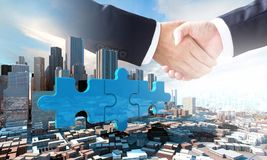 Merger and acquisition business concept, join puzzle pieces. Merger and acquisition business concept, join company on puzzle pieces and handshake, 3d render Stock Photos