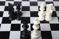 Merger and Acquisition. Chess pieces on a chessboard indicating merger and acquisition with white background Royalty Free Stock Image