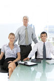Merger and acquisition. Management team. Portrait of three managers of a business company Stock Image
