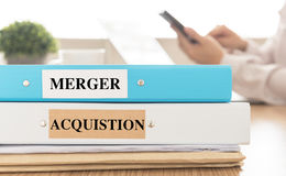 Merger acquistion. Mergers and Acquisitions doucuments place on desk in meeting room.  merger, acquistion, business concept Royalty Free Stock Photo