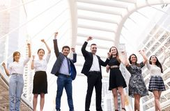 Mergers and acquisition,Successful diversity group of business people,Teams success achievement hand raised up royalty free stock photo