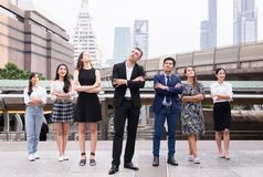 Mergers and acquisition,Successful group of business diversity people,Team success achievement hand cross arms over blurred buildi. Mergers and acquisition royalty free stock photo