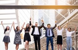 Mergers and acquisition,Successful group of business people,Team success achievement hand raised up. Merger and acquisition,Successful group of business people royalty free stock image