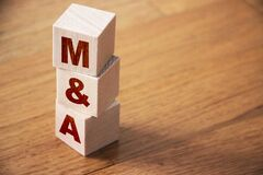 Free Mergers And Acquisitions, M And A Business Concept. Letters On Wooden Cubes Royalty Free Stock Photos - 192094488