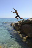 Mergulho do menino no mar Imagens de Stock Royalty Free