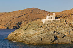 Merichas port lighthouse, Kythnos island, Greece Royalty Free Stock Photo